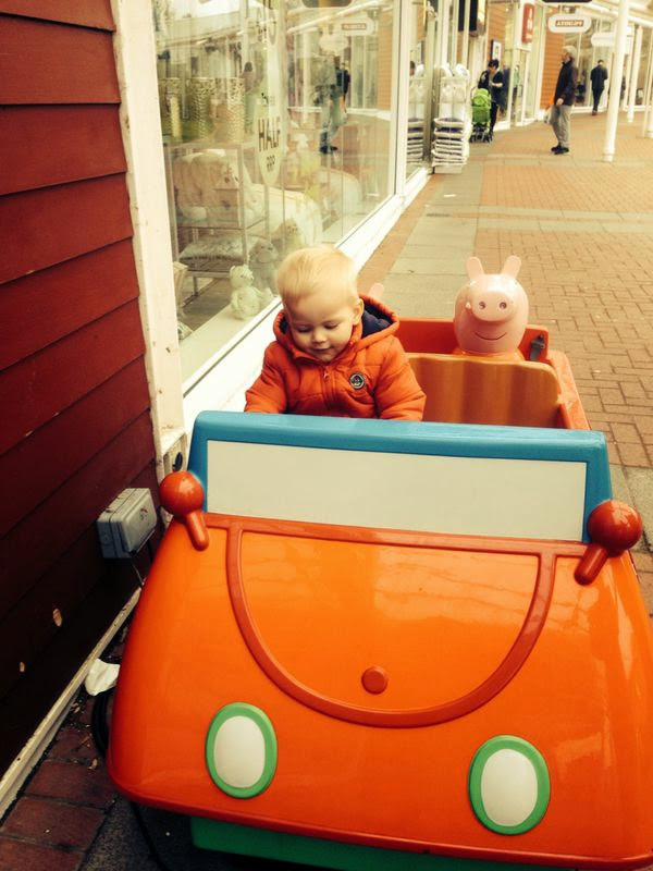 Toddler in a car ride with peppa pig