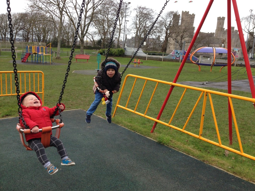 playground in caernarvon with the castle overlooking