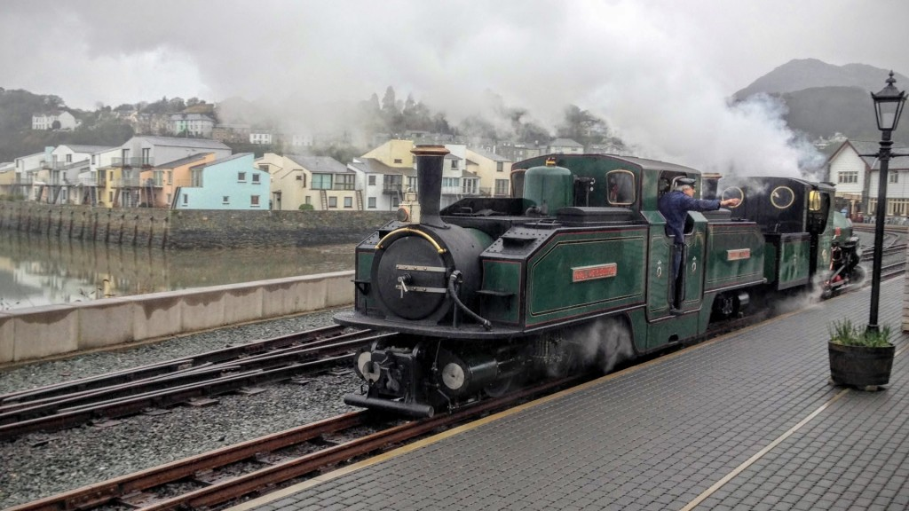 steam train on welsh highland railway in porthmadog