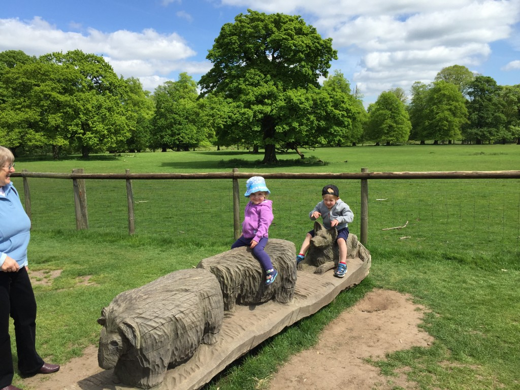 Wooden carved animals at Tatton park on the way to the farm