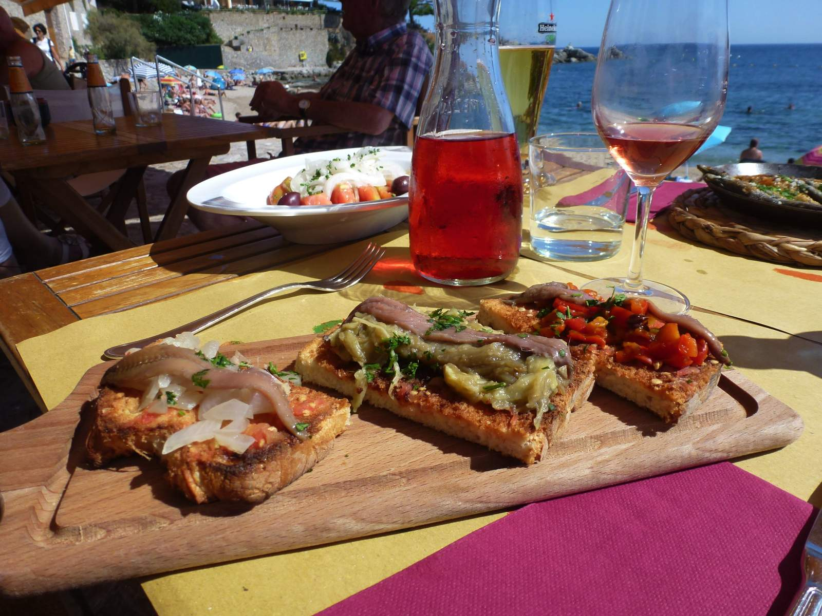 bread and wine on a table on the catalan coast, catalonia