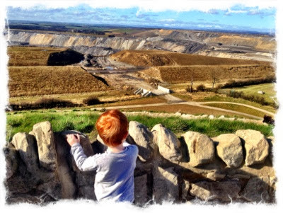 north east family fun toddler over looking open cast mine at northumberlandia