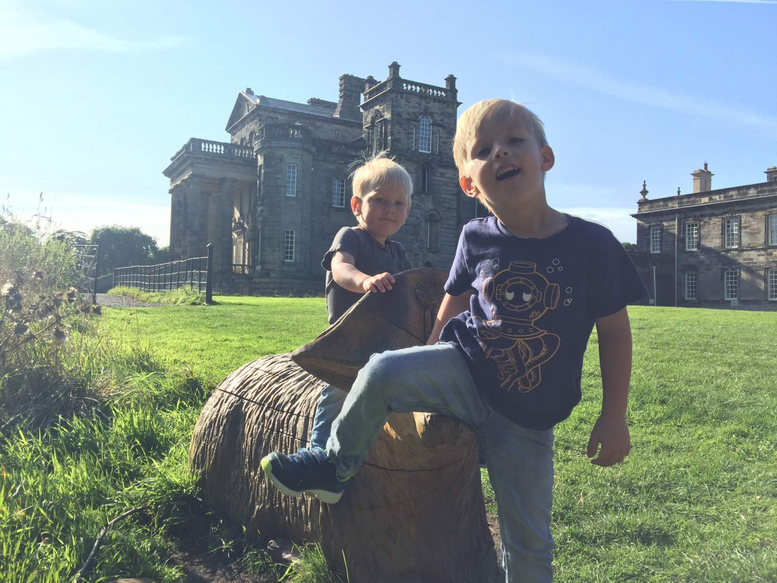 riding on a wooden sheep at seaton delaval hall