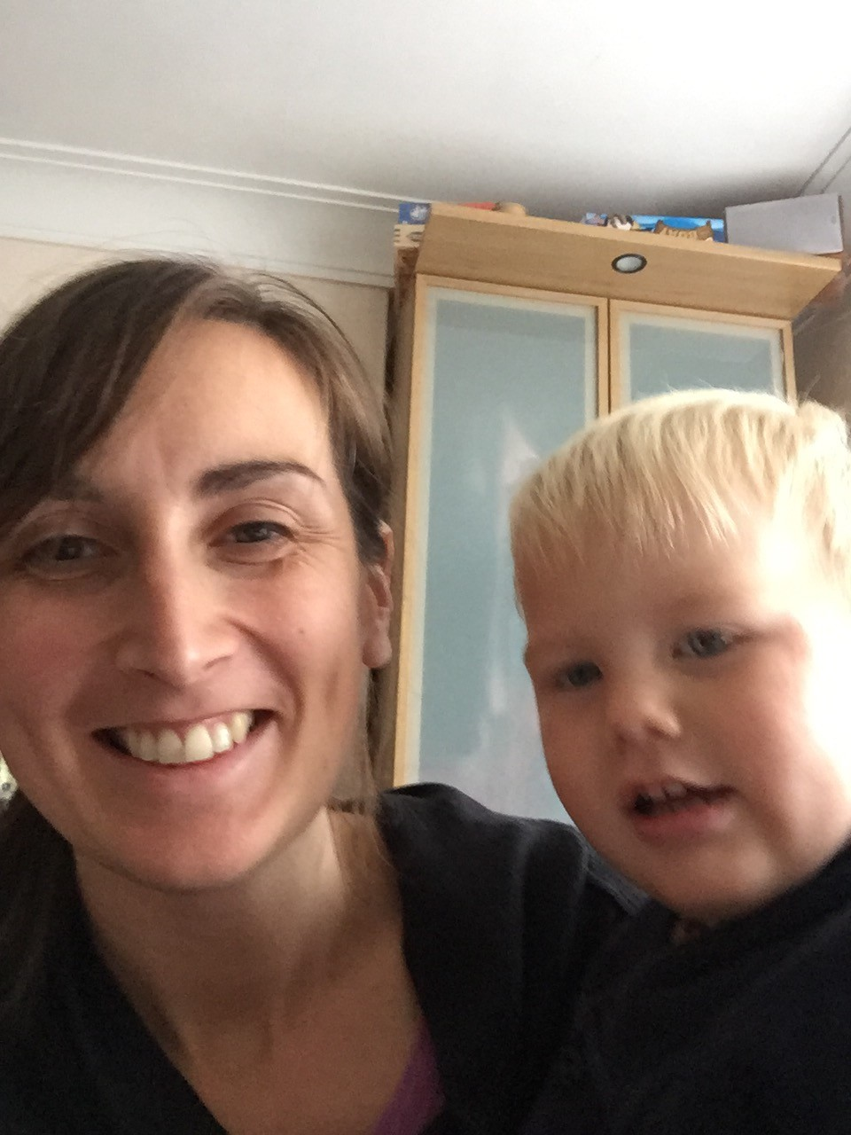 blurred photo of mum and toddler smiling