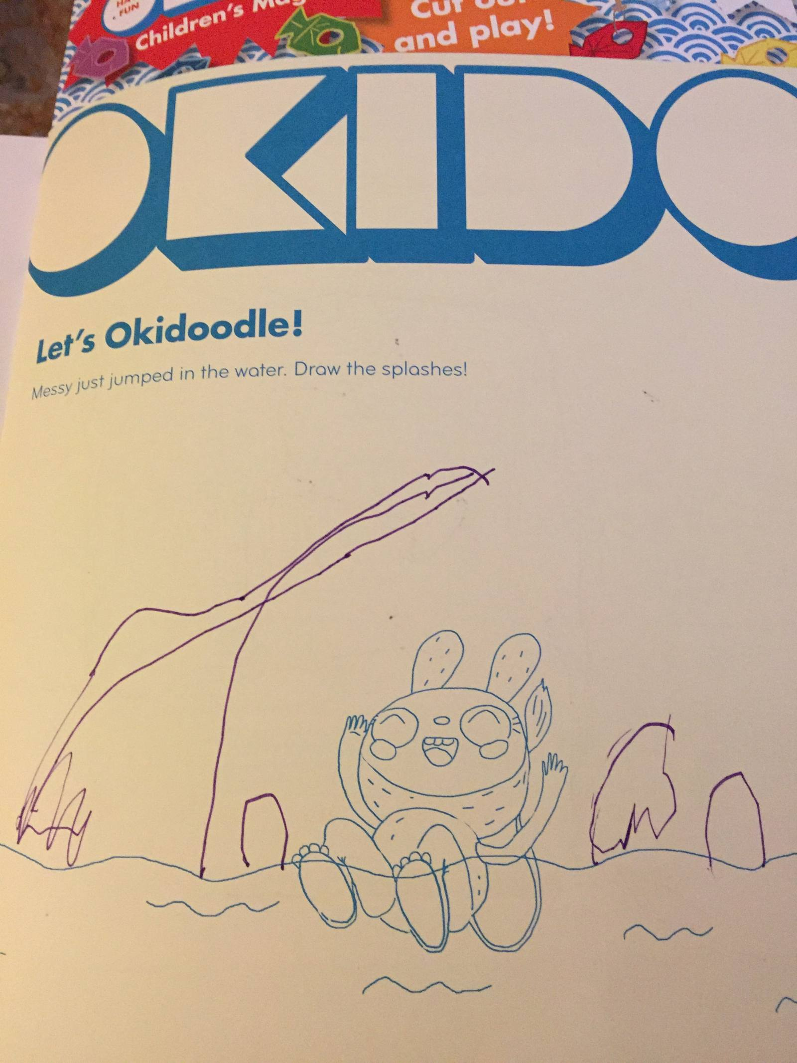 okidoodle in okido children's magazine messy jumped in water child draws the splash