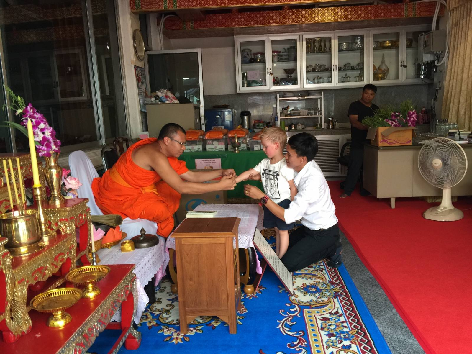 blessing from a buddhist monk at wat pho