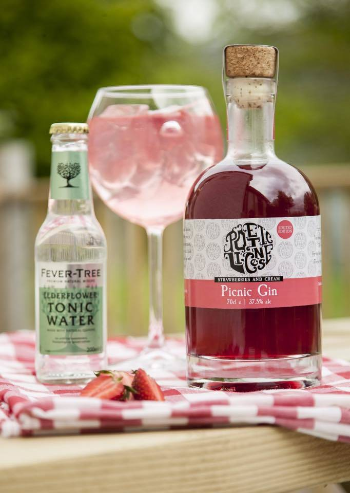 poetic license picnic gin with a glass full of yummy gin, next to a bottle of tonic