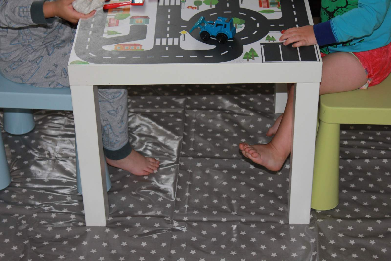 ikea lack table makes an ideal table for little children, especially when there's no room in the home for a permanent family table