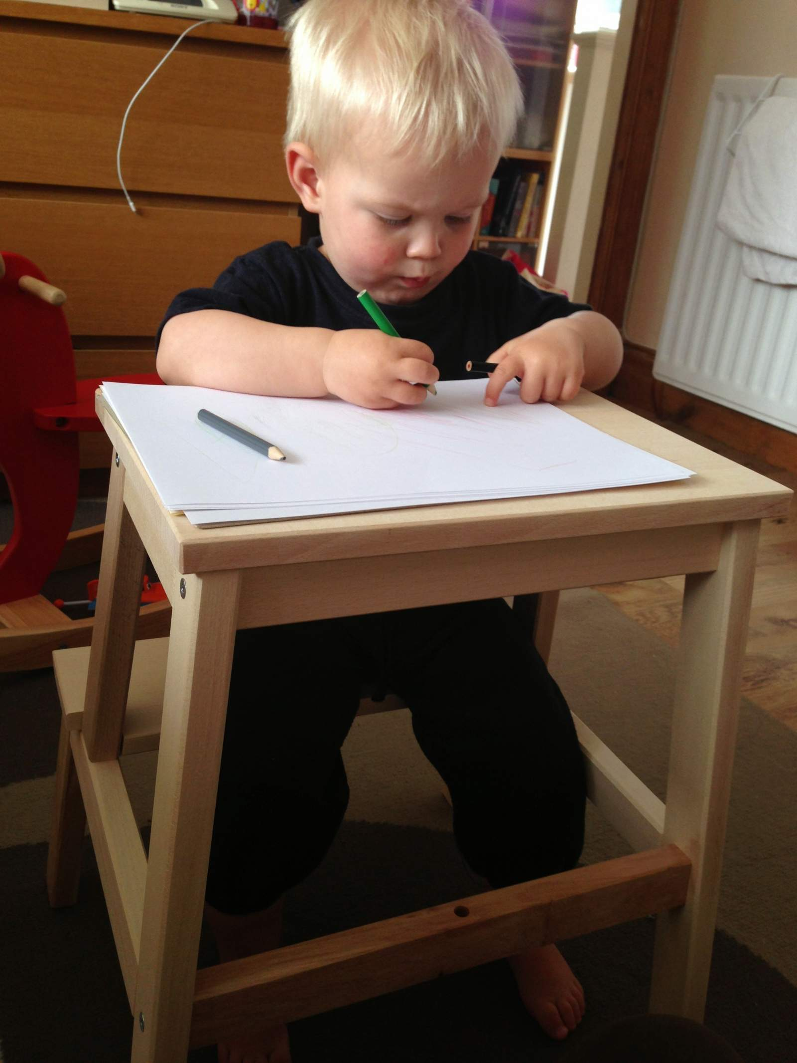 ikea footstool as a table for a toddler