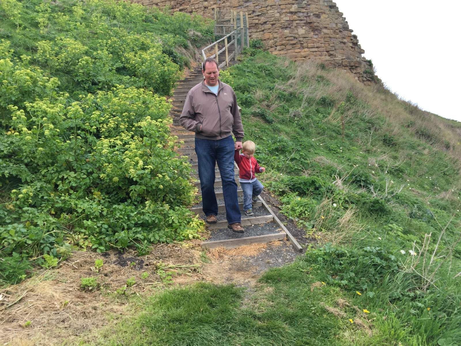 walking down the steps outside tynemouth priory