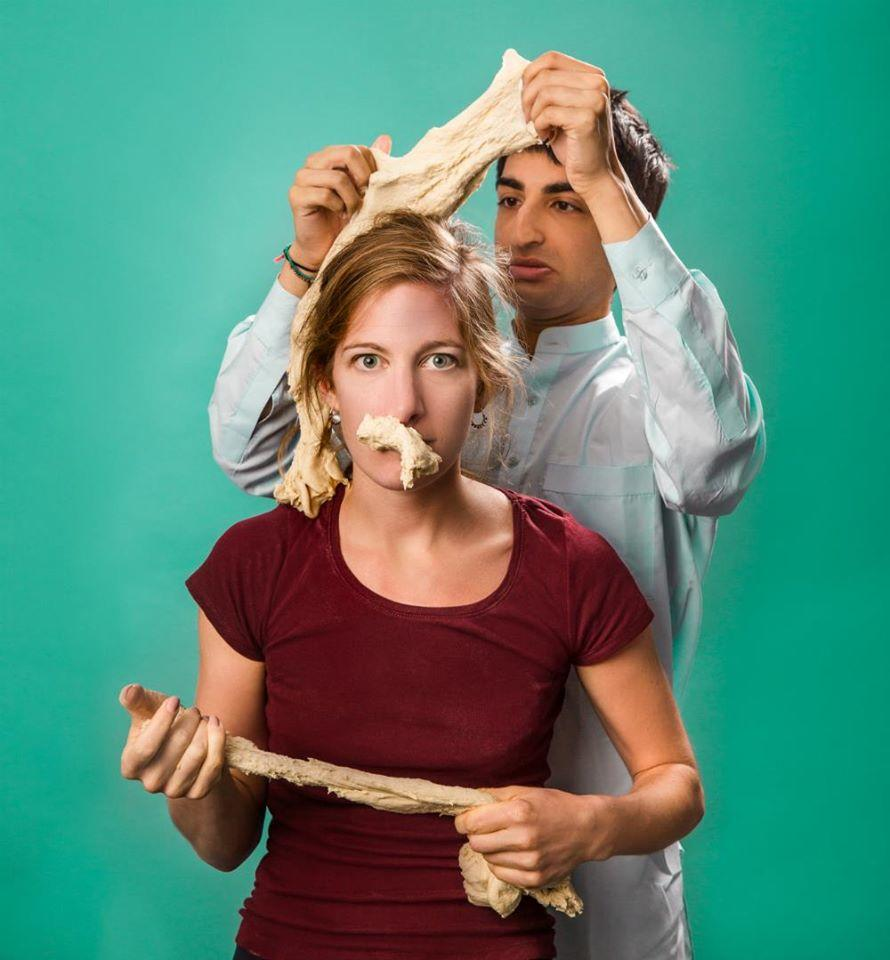 man behind woman who has dough on her face and hair, and hands