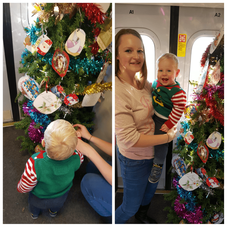 hanging a bauble on the train christmas tree days out with a toddler something about baby