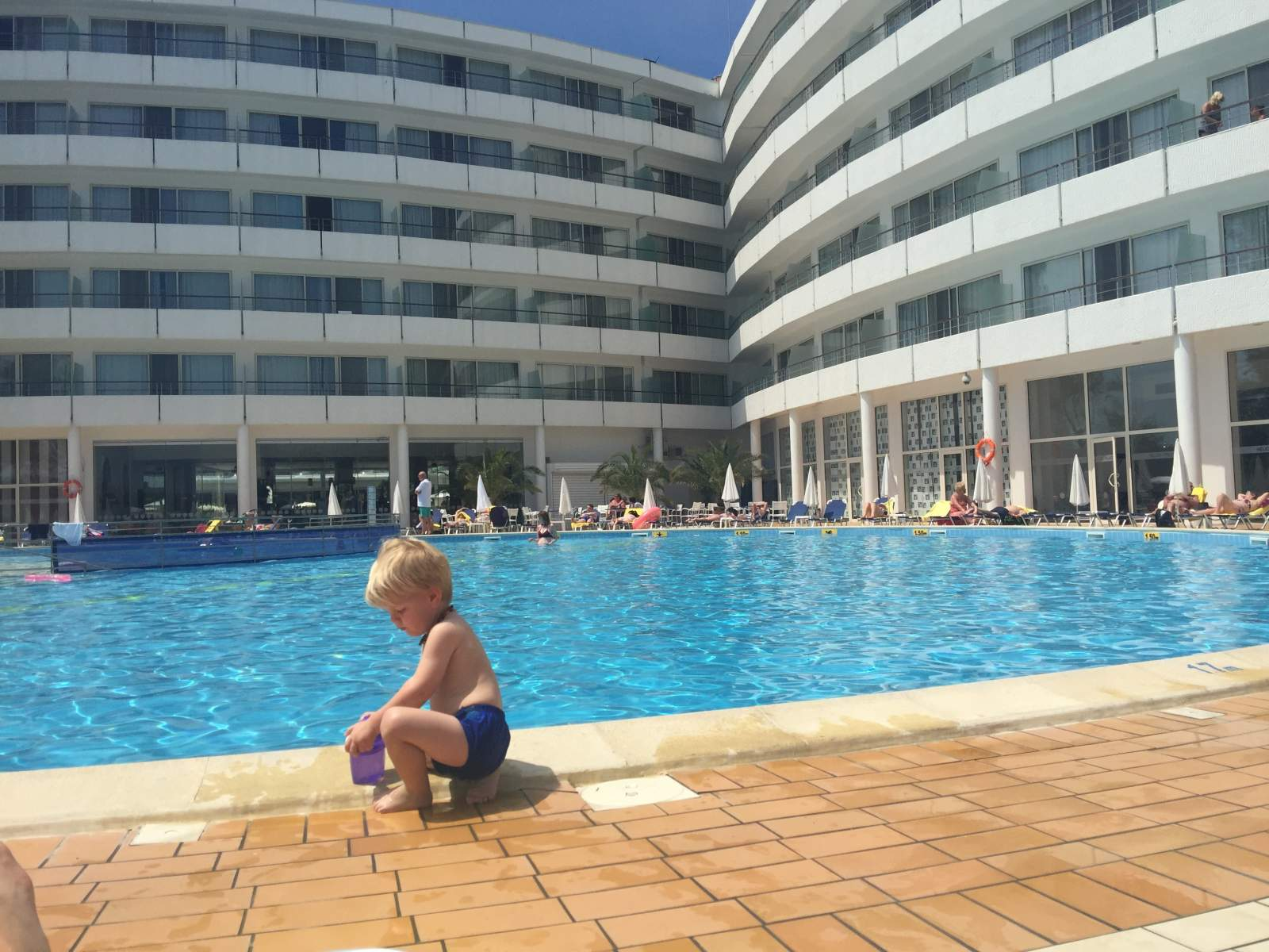 toddler playing by one of the pools at riu hotel helios sunny beach bulgaria