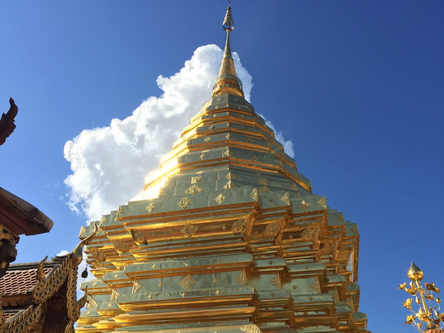 thailand with kids and a photo of a bit of the golden roof at the temple in Chiang Mai mountain temple