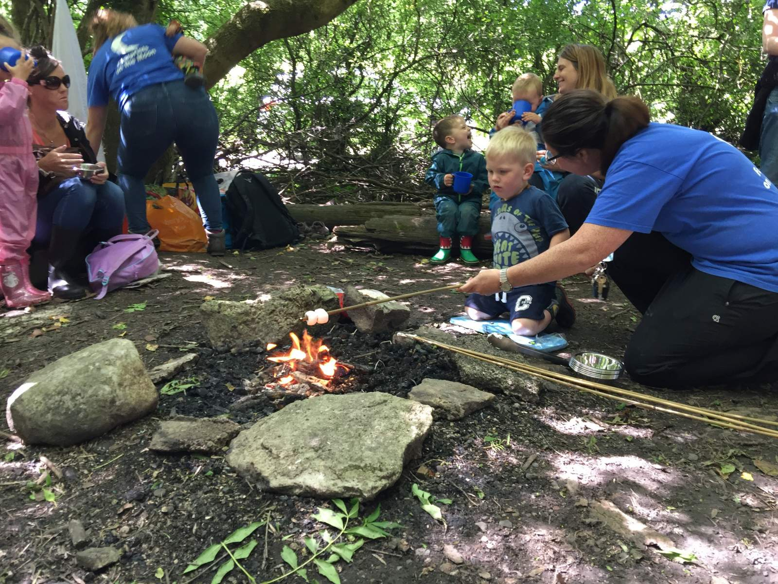 toasting marshmallows on the camp fire at forest school in plessey woods