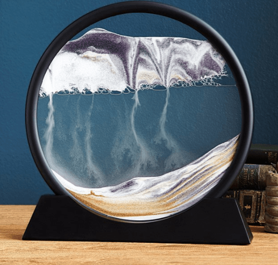 Deep Sea Sand Art Bring a calming presence to your office with this desk sculpture that forms natural landscapes with sand.