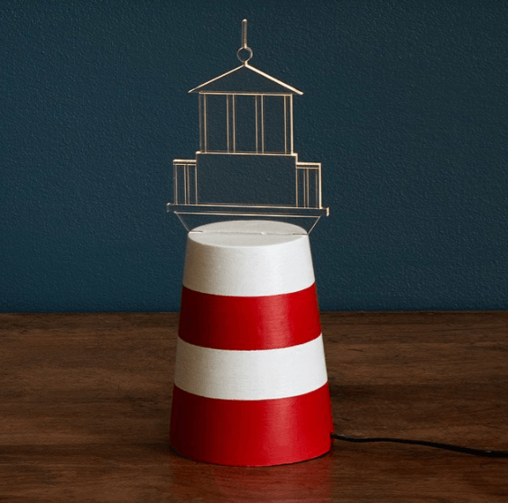 LED Lighthouse Lamp Add a nautical note to your decor with this concrete and acrylic lighthouse LED lamp.