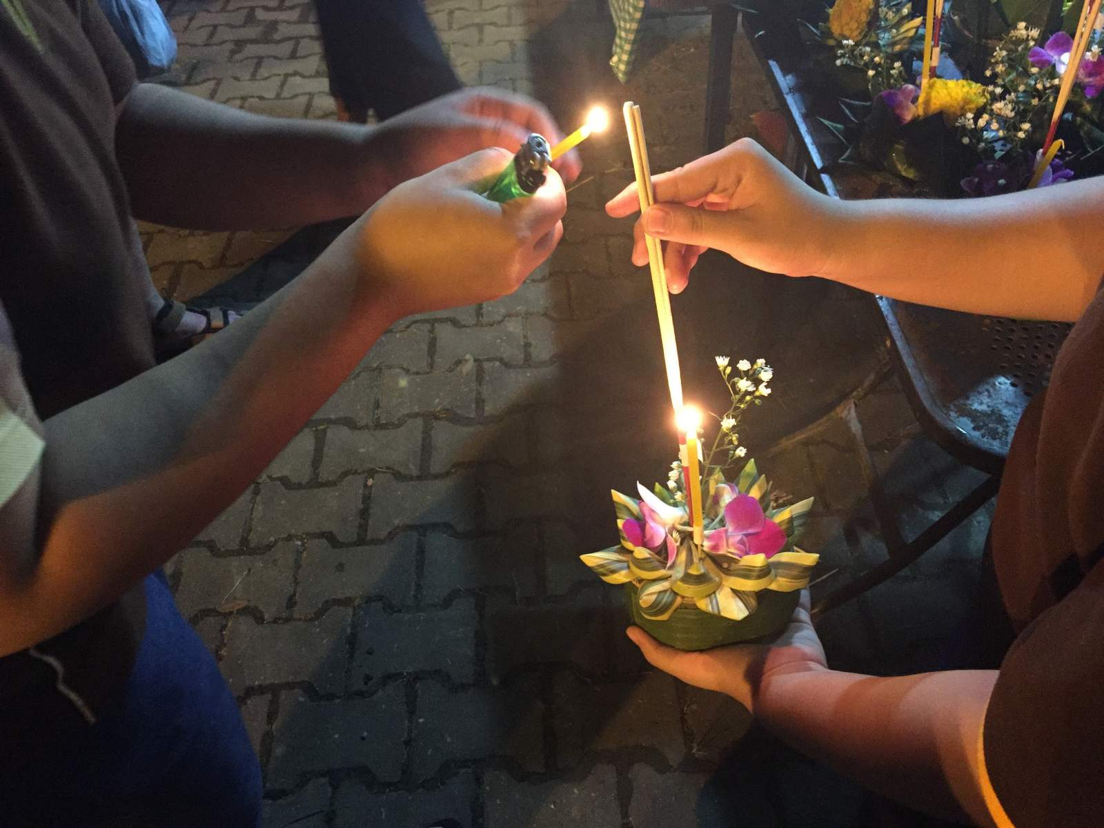 lighting the candle in a krathong in chiang mai