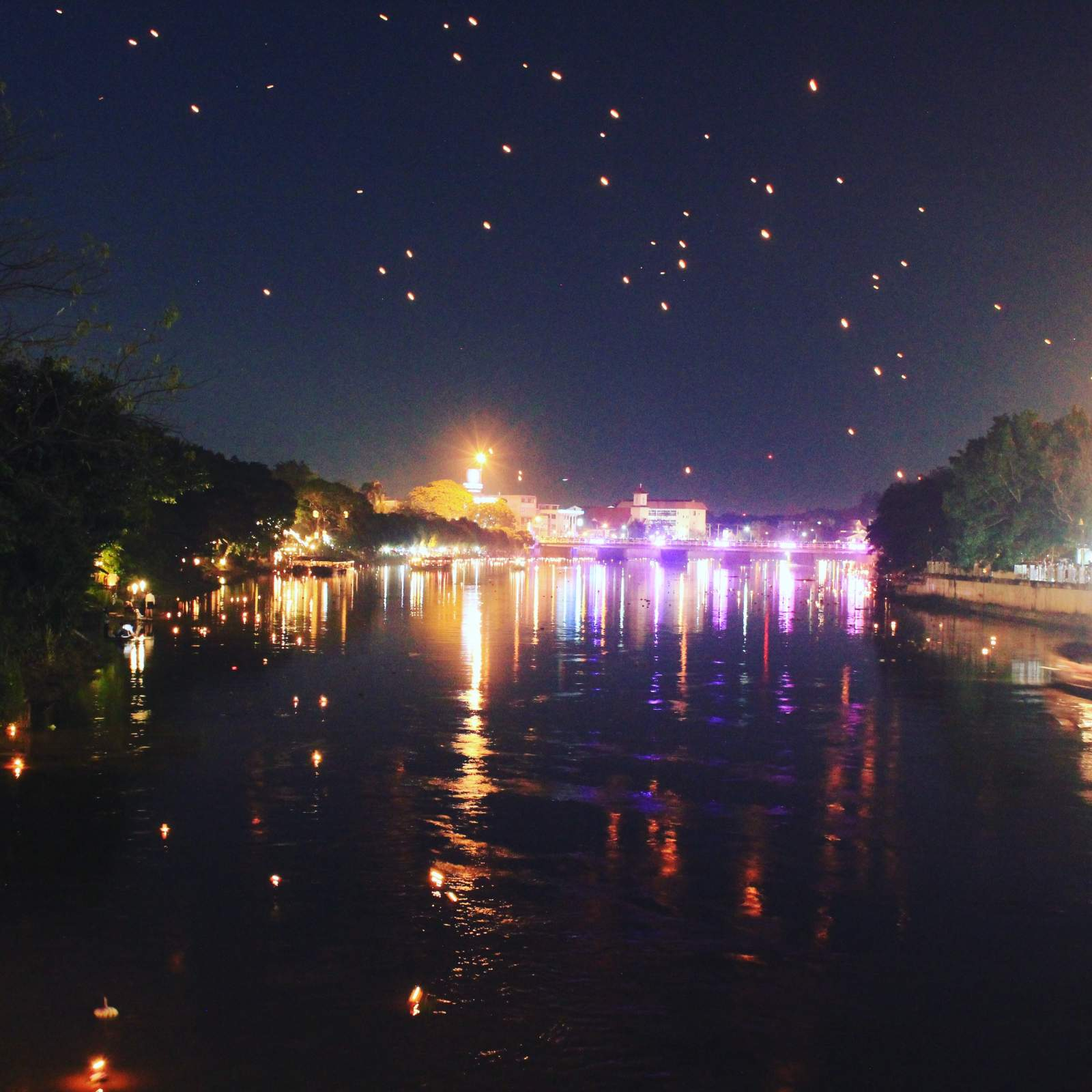 loy krathong lanterns in sky krathong on water chiang mai