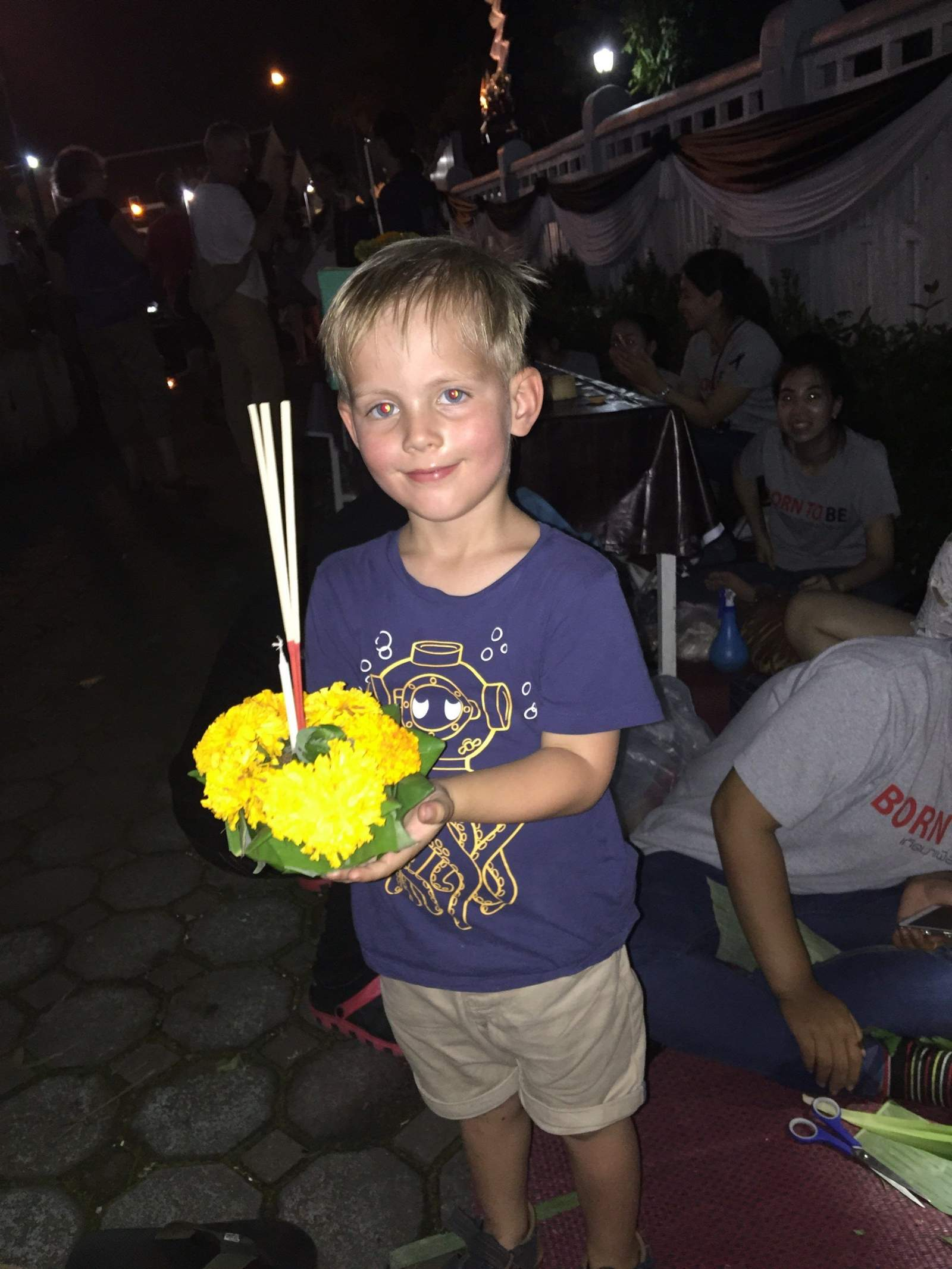 with the krathong he made with students in chiang mai