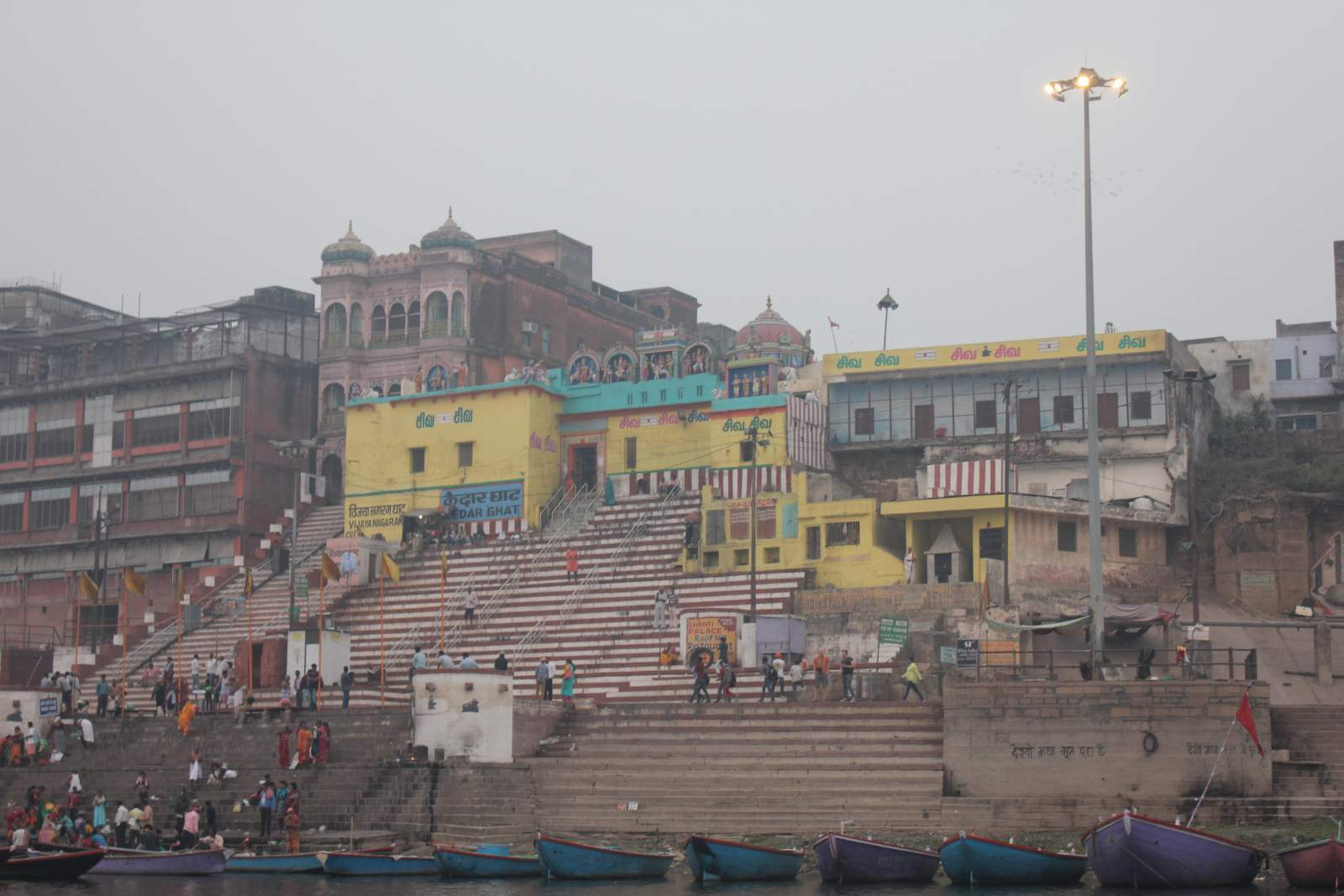 yellow building on ghat in varanasi