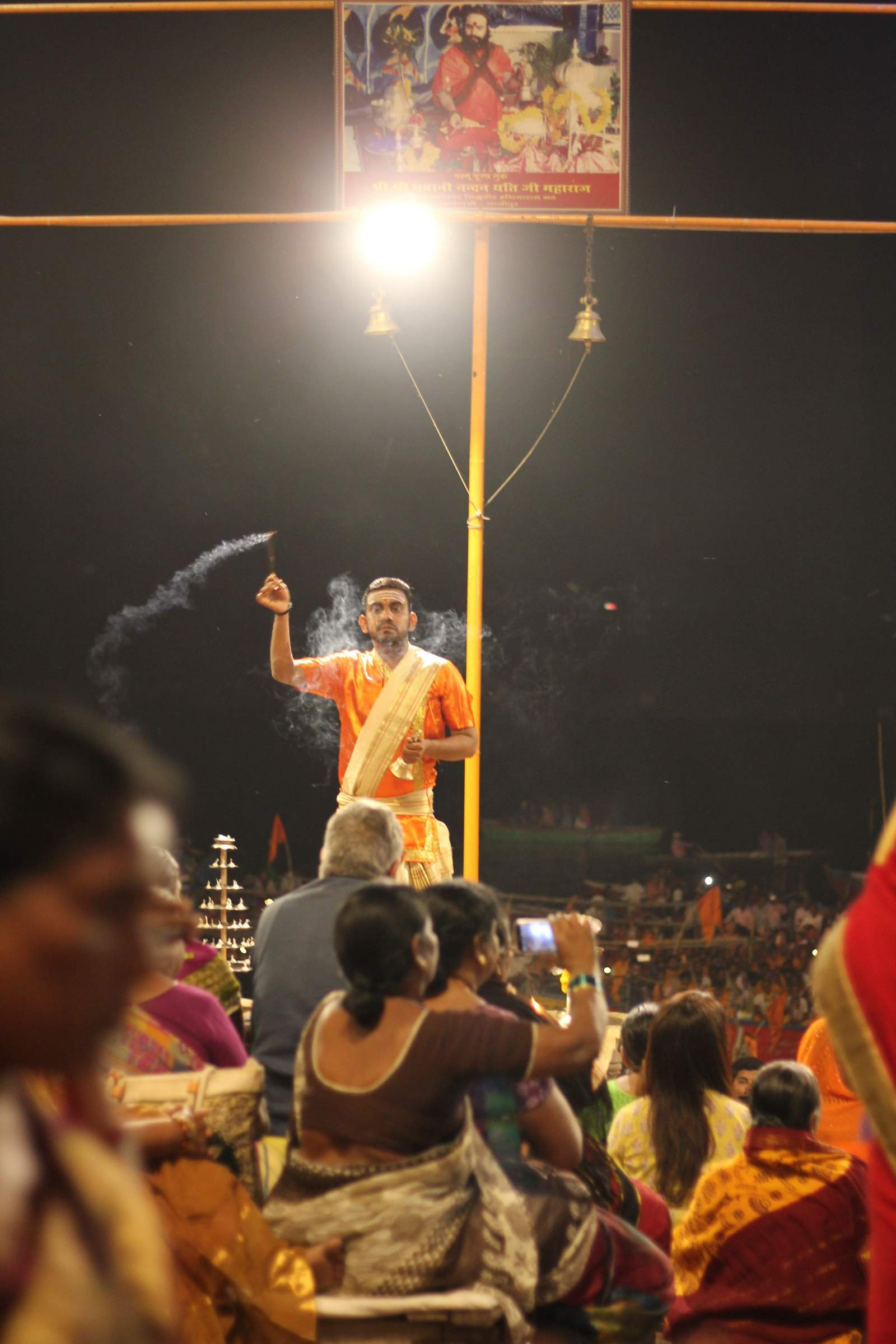 priest on the stage at the gange aarti varanasi February 2018