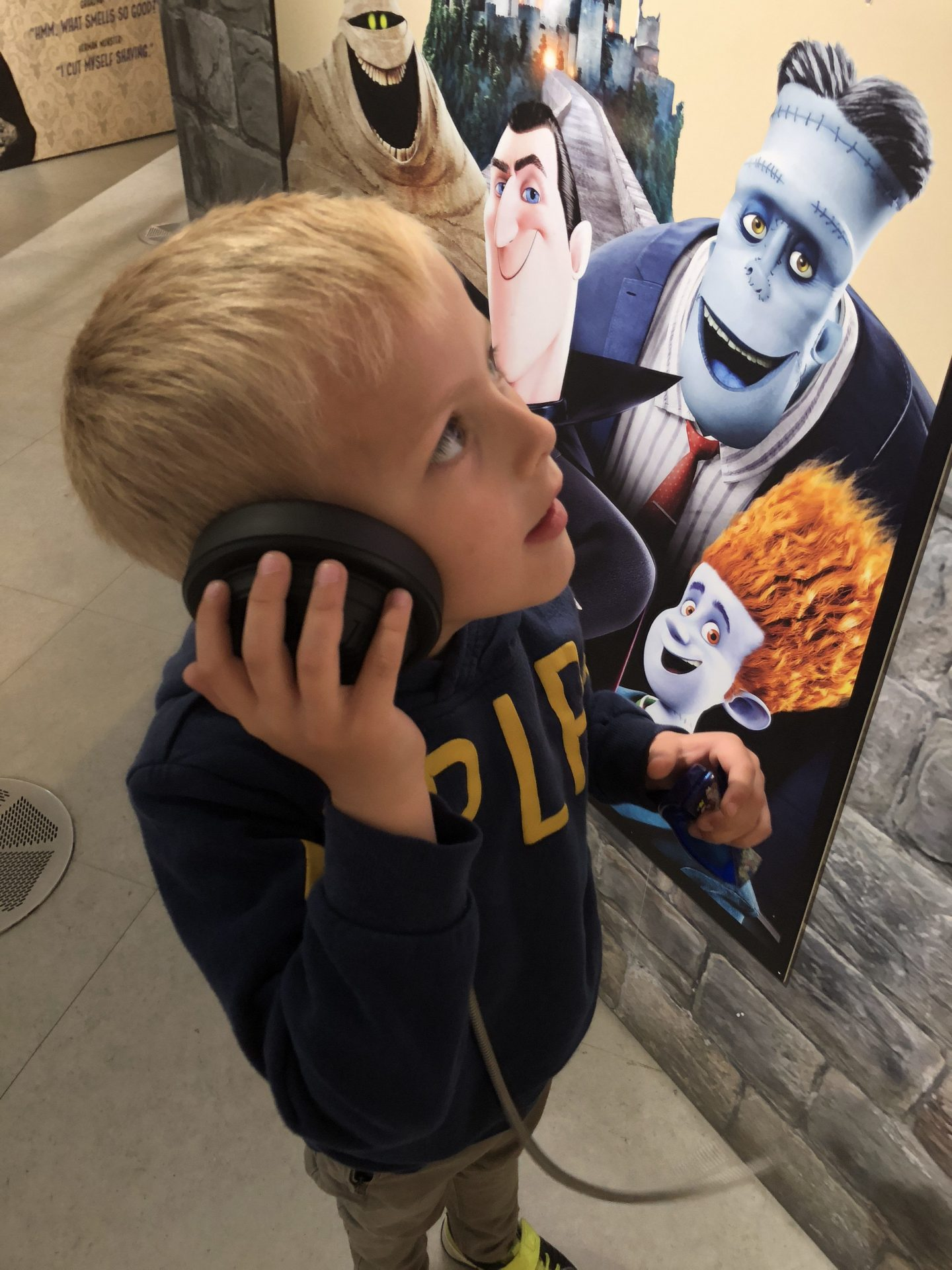 Boy listening to monsters at The Word South Shields