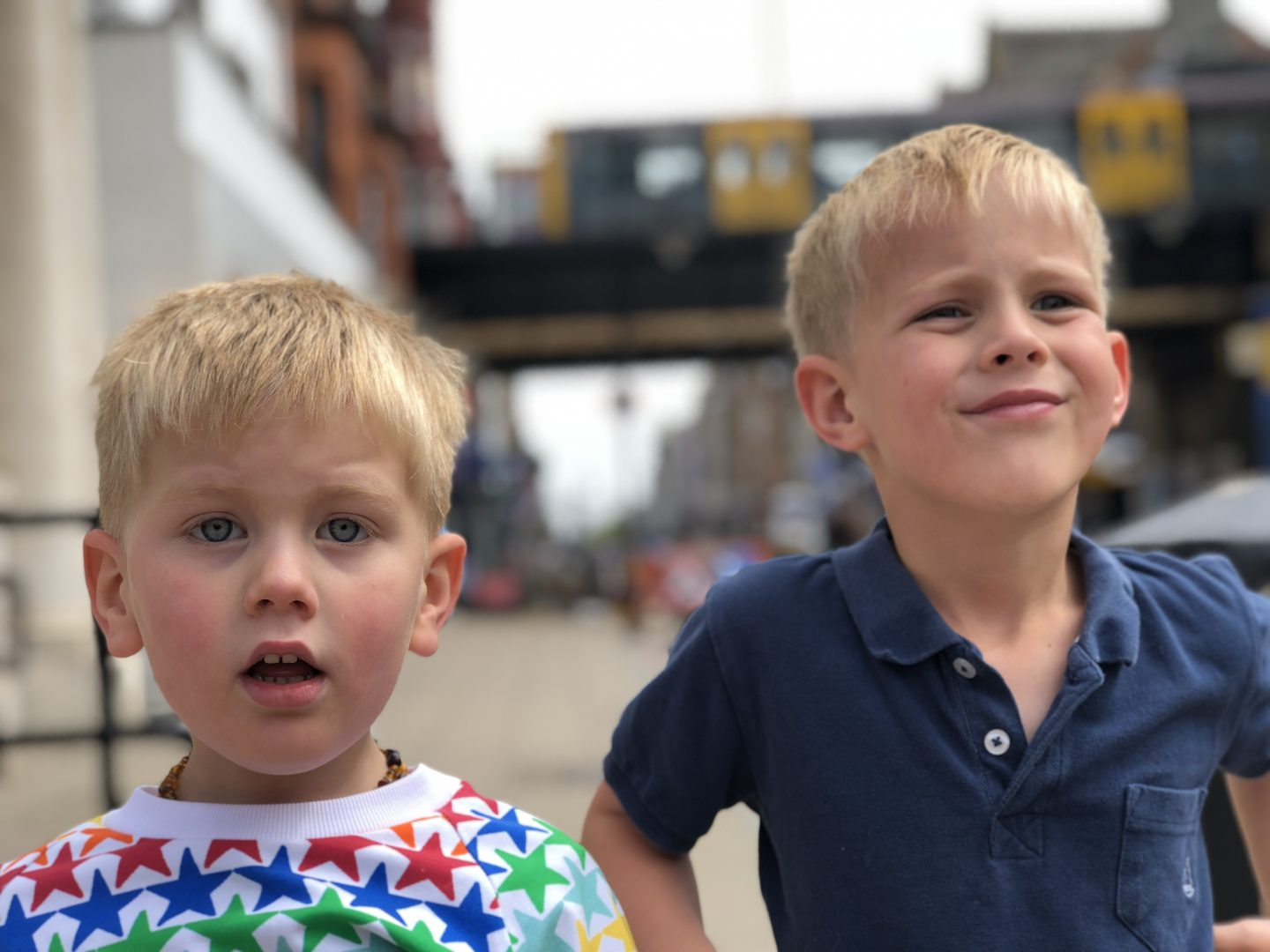 Two boys in South Shields with the Metro behind them