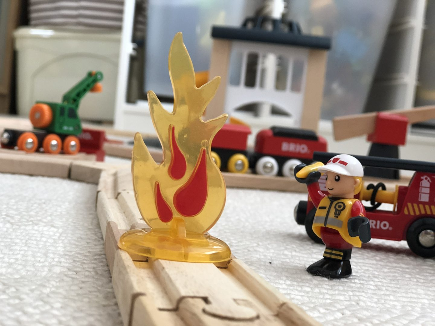 Fire on the BRIO train track fire engine man to put out