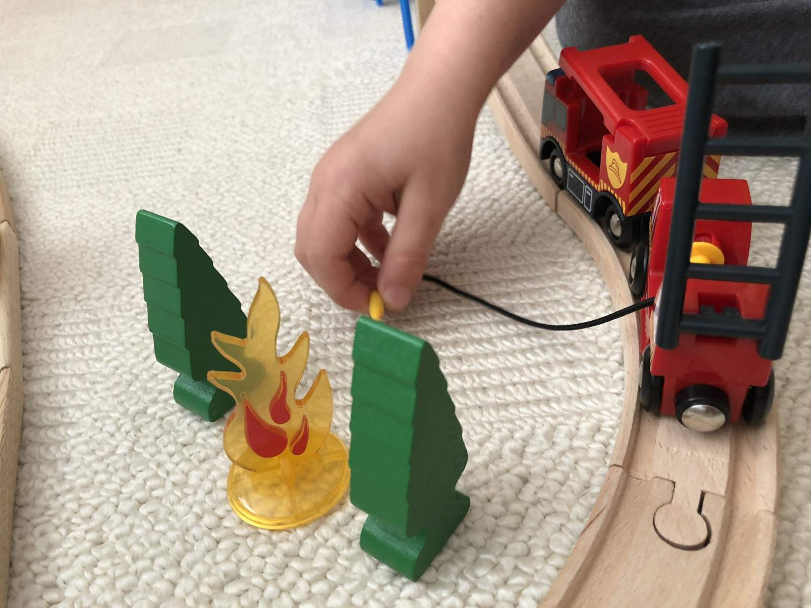 putting out the fire in the BRIO trees fire engine toy
