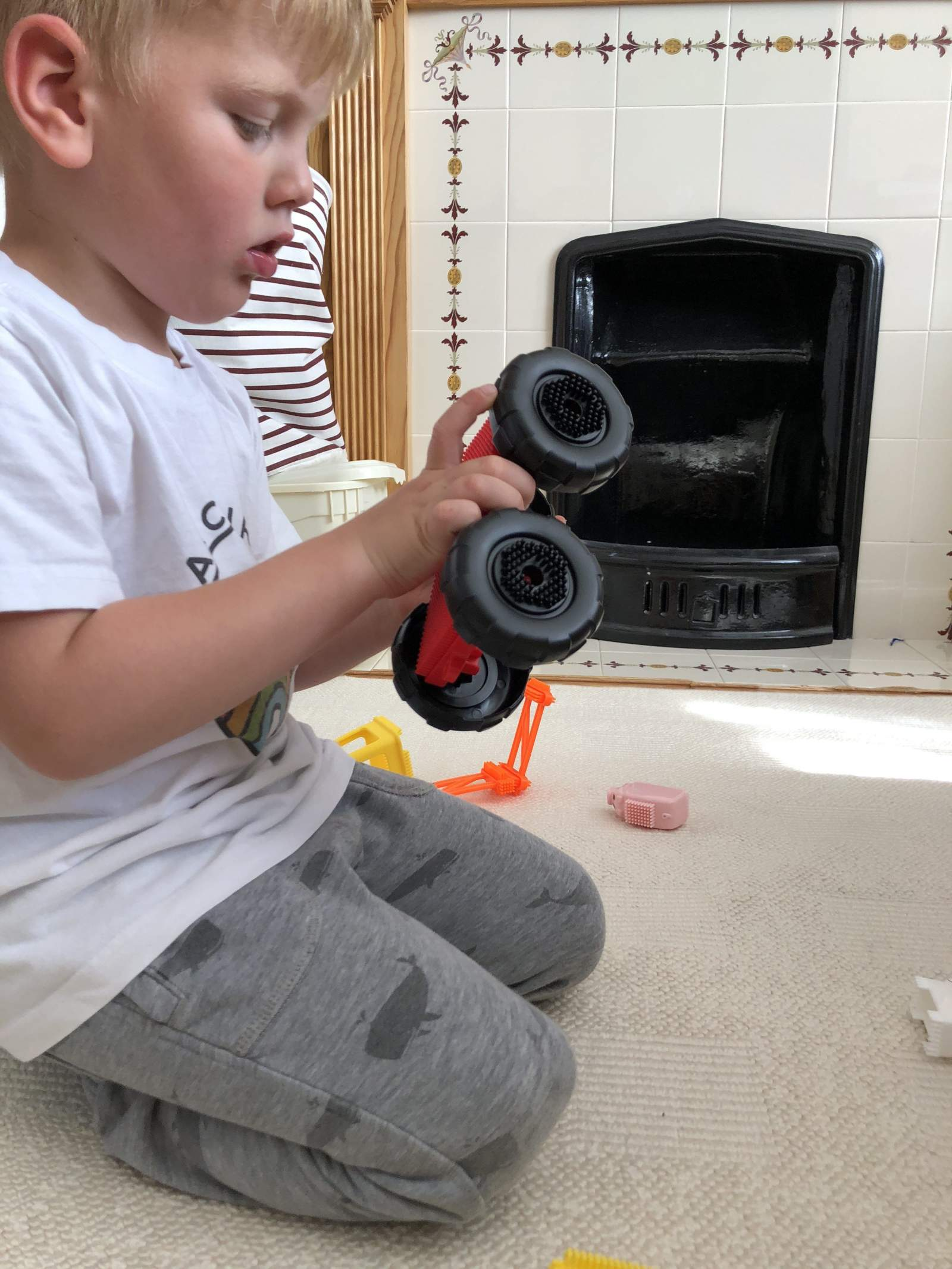 boy building a stickle brick tractor
