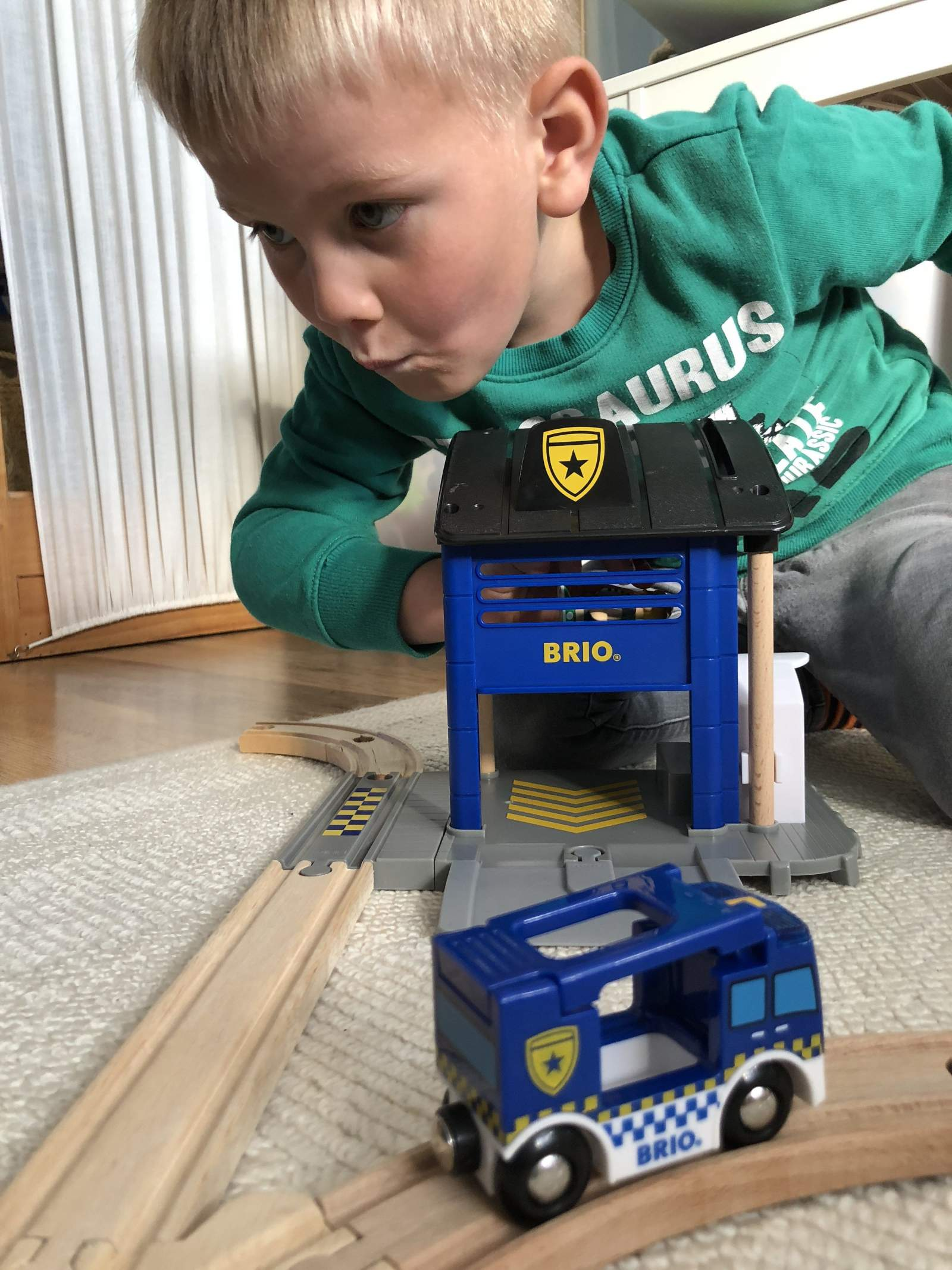 boy playing with brio police station