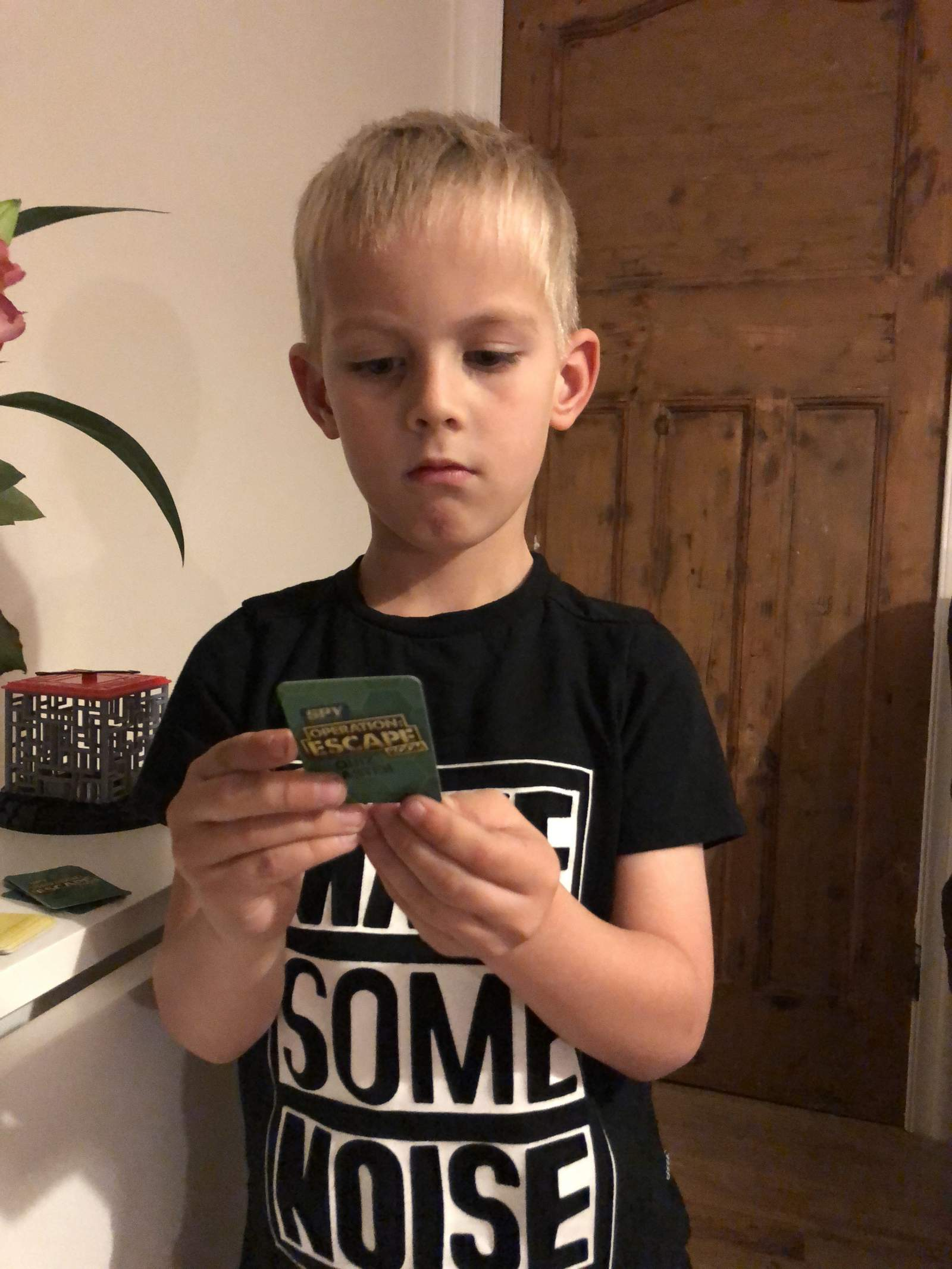 operation escape room game reading a quiz master card