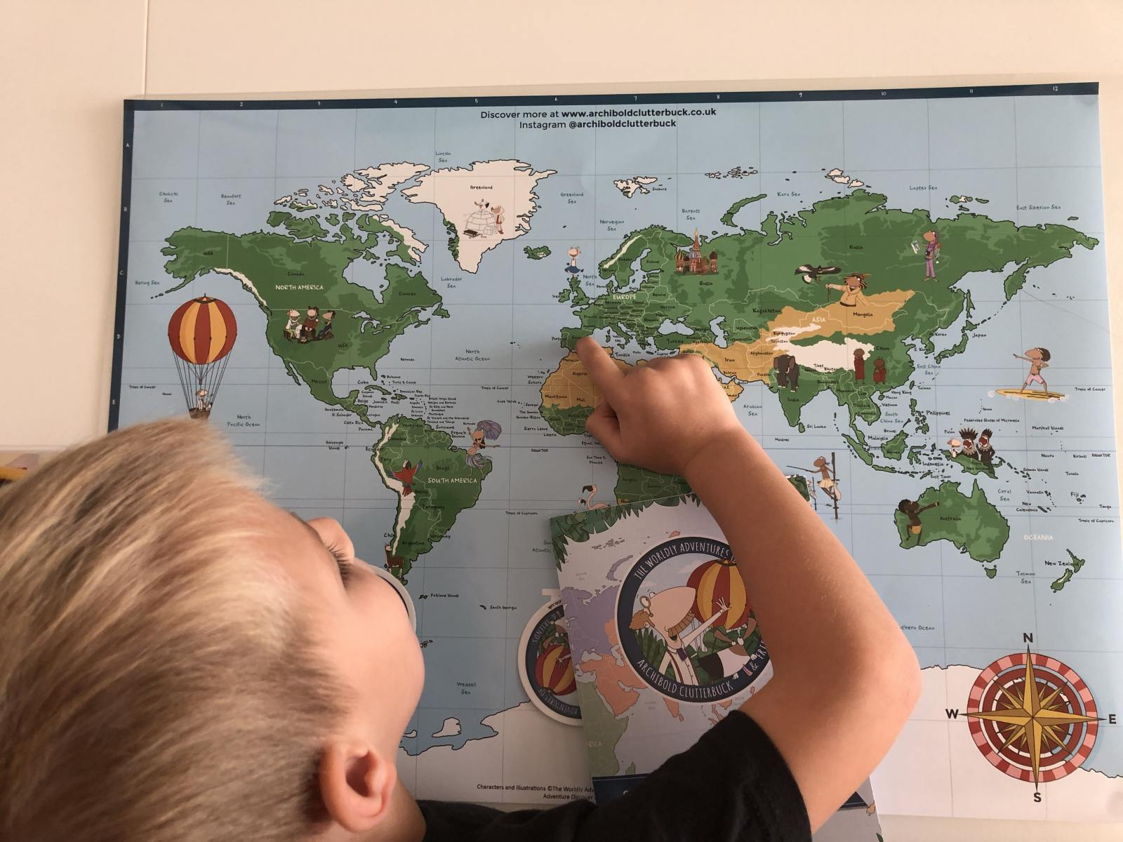 Archibold Clutterbuck world map boy pointing to europe
