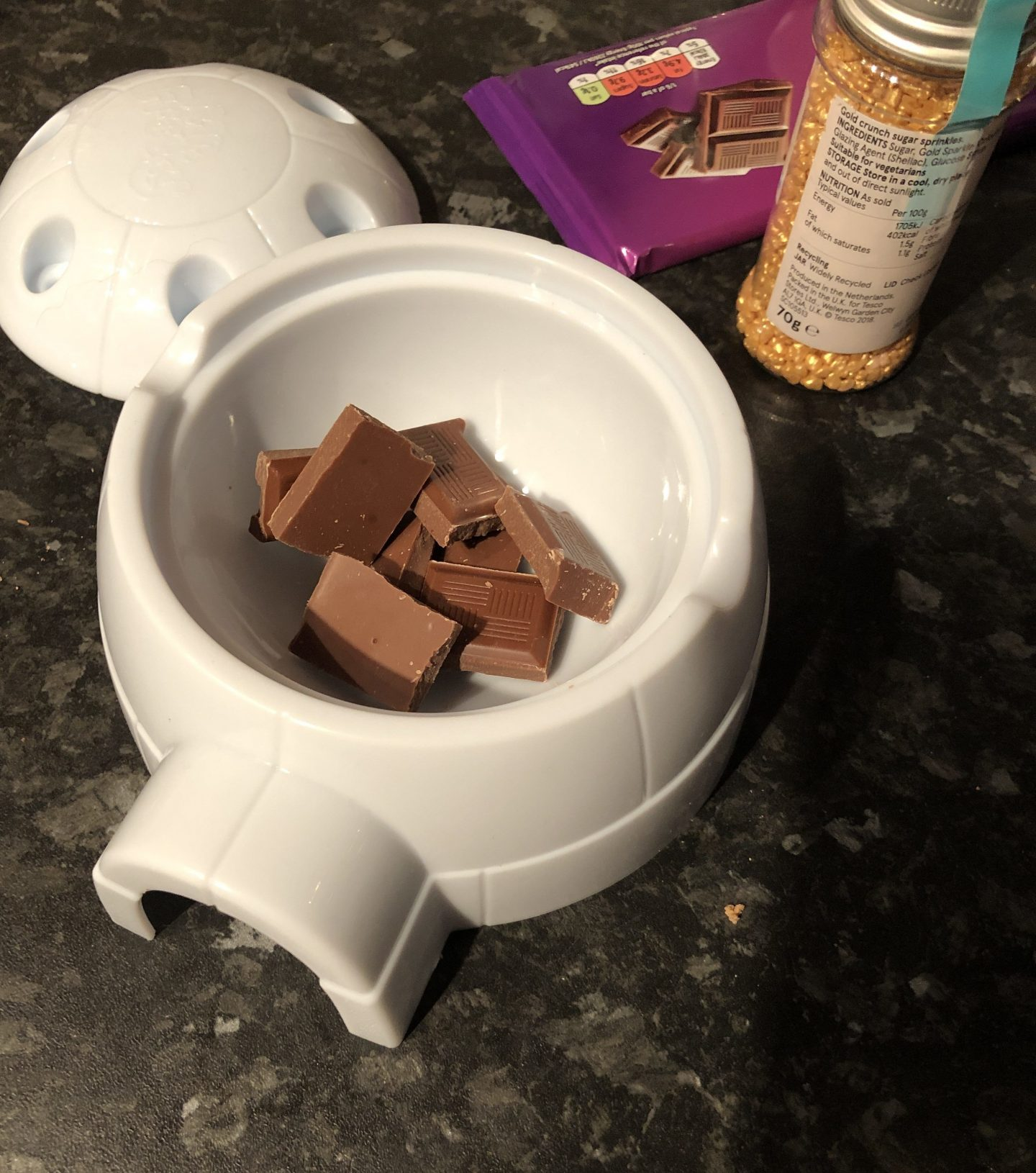 break chocolate into the igloo of the mr frosty choc ice maker before melting it in the microwave