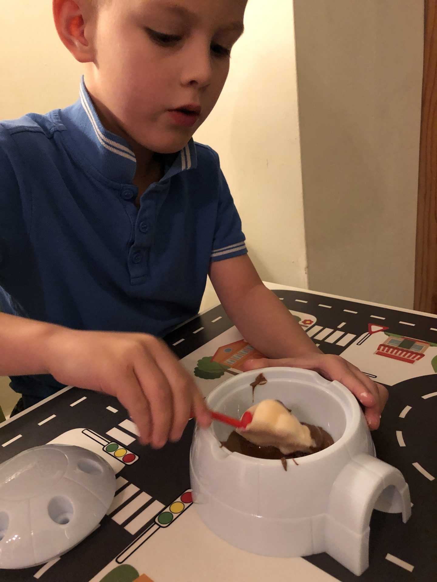 dipping mr frosty choc ice into chocolate igloo