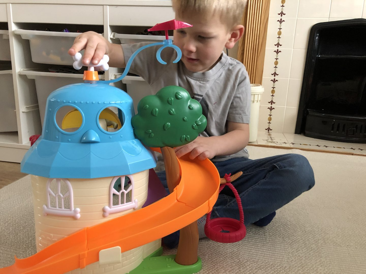 boy playing with puppy dog pals doghouse playset