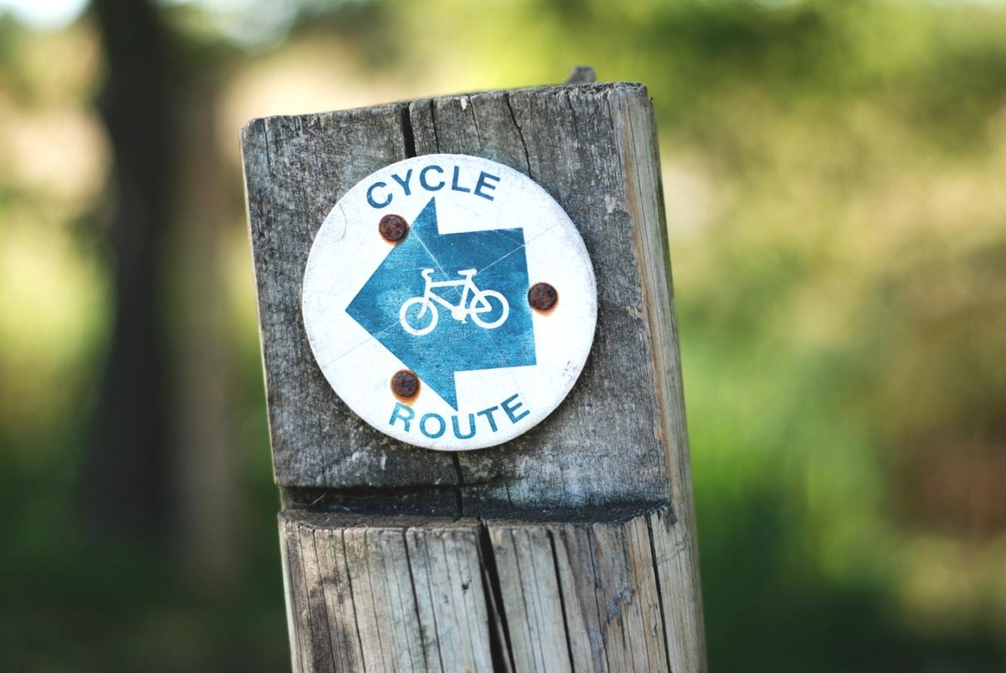 cycle route sign arrow on post
