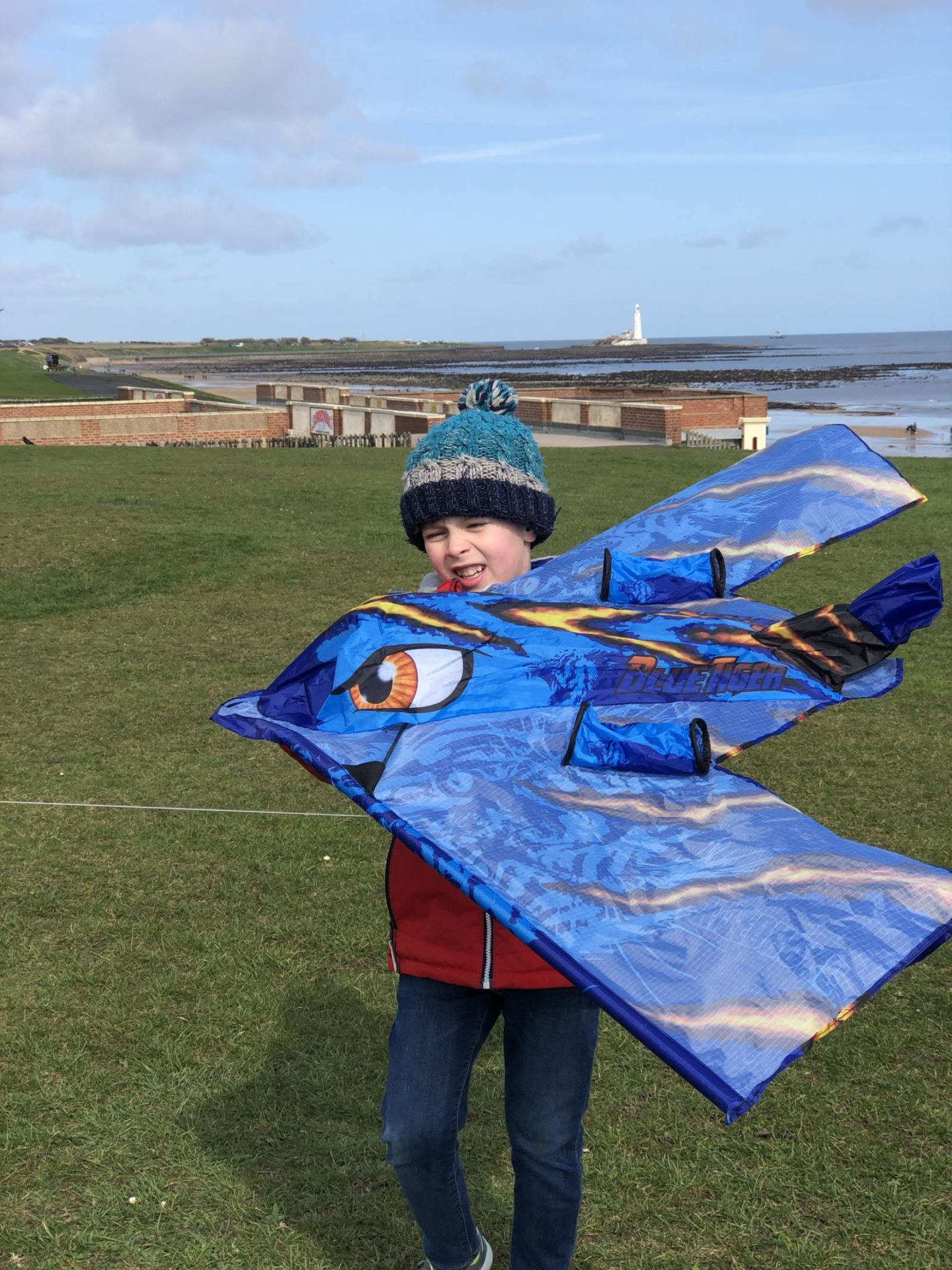 kitedrone kite with st marys lighthouse in the background